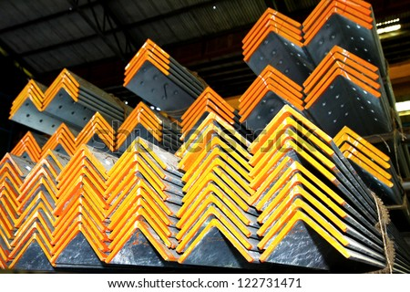 Texture of orange steel angles bunch before shipment - stock photo