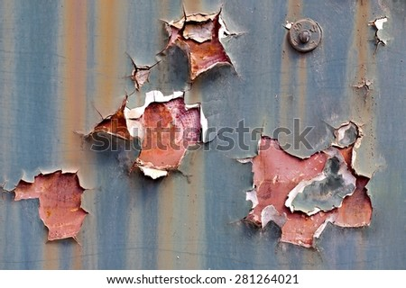 Texture of paintwork falling apart on metal surface - stock photo