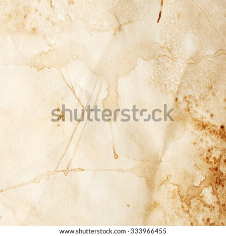 Texture of paper with blots of coffee