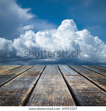 Texture of perspective Old wood floor and cloudy sky - stock photo