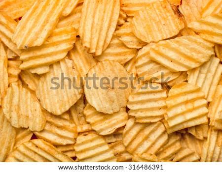 Texture of potato chips close-up. - stock photo