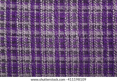 Texture of purple tartan fabric useful as a background - stock photo