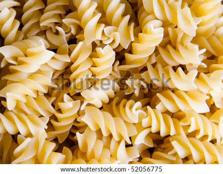 Texture of raw macaroni - spiral - stock photo