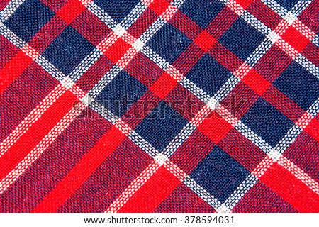 Texture of red and blue a checkered woolen fabric - stock photo