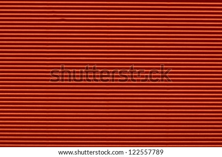 Texture of red corrugated paper for background used - stock photo