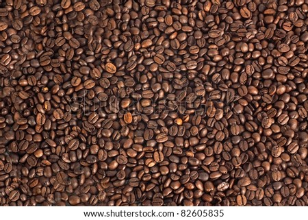 Texture of roasted coffee beans - stock photo