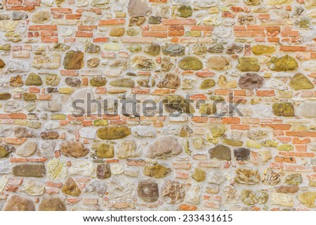 Texture of rock wall overgrown with moss, can be used as background - stock photo