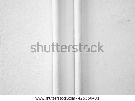 Texture of rough white wall with white pipes outdoors creating a nice composition - stock photo