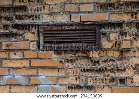 texture of ruined brick wall with lattice - stock photo