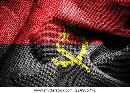 Texture of sackcloth with the image of angola flag - stock photo