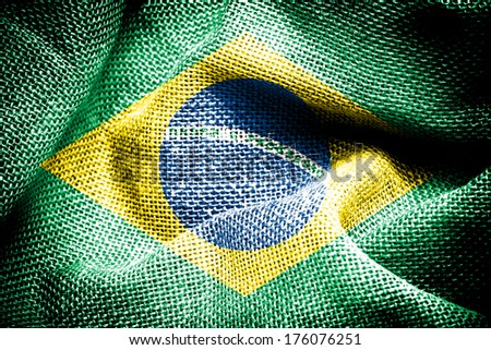 Texture of sackcloth with the image of Brazil Flag.  - stock photo