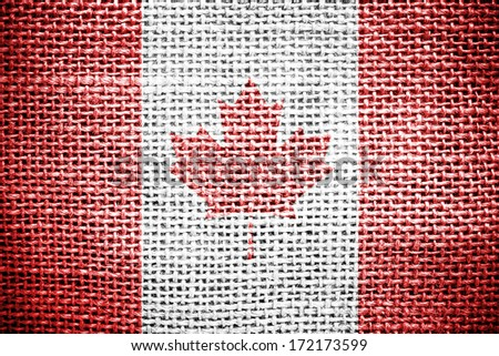 Texture of sackcloth with the image of the Canada Flag.  - stock photo