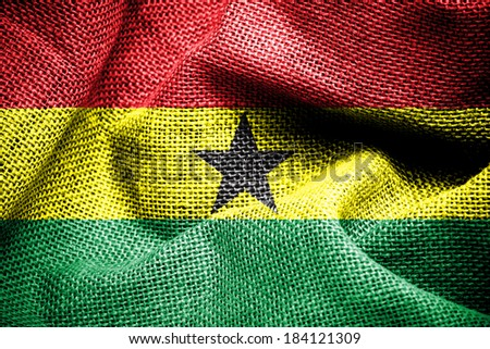 Texture of sackcloth with the image of the Ghana flag  - stock photo
