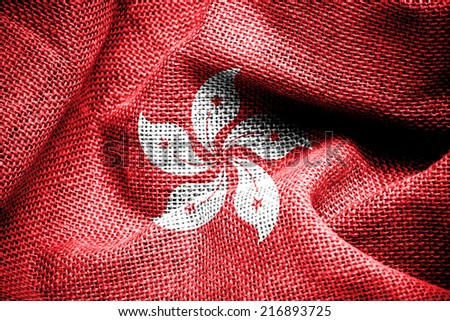 Texture of sackcloth with the image of the Hong Kong flag - stock photo