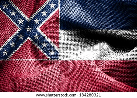 Texture of sackcloth with the image of the Mississippi flag - stock photo