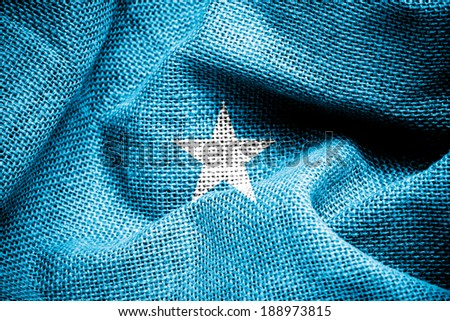 Texture of sackcloth with the image of the Somalia flag  - stock photo