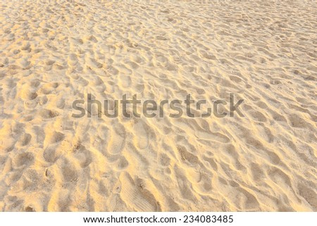 Texture of sand and footprints in the sand - stock photo