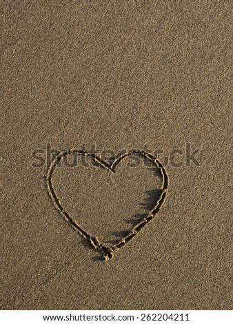 Texture of sand and heart  in the sand - stock photo