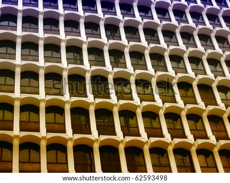 Texture of skyscraper windows background in Hong Kong - stock photo