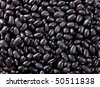 Texture of small black beans. Image of raw food - stock photo