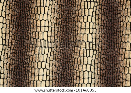 Texture of snake on fabric background - stock photo