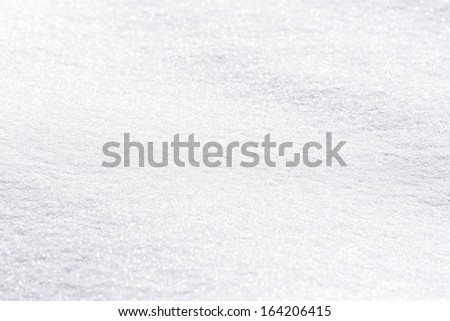 Texture of snow on sunny day - stock photo