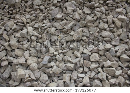 Texture of stone rubble, surface with a large number of stones - stock photo