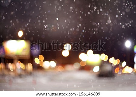 texture of the city lights the first snow - stock photo