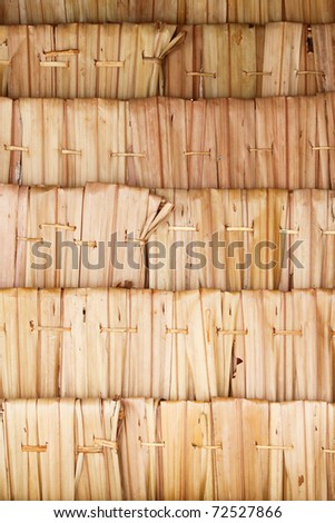 Texture of the classic thatch roof from inside view - stock photo