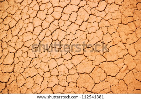 texture of the crackled red clay in the desert - stock photo
