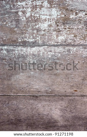 texture of the grey wall that has old wooden boards and the paint faded - stock photo