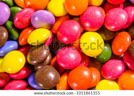 Texture of the many multicolored candies for background