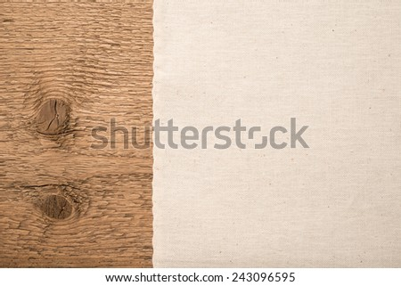 Texture of the natural cotton fabric and wood   - stock photo