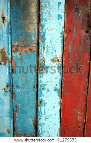 texture of the orange wall that has old wooden boards and the paint faded - stock photo