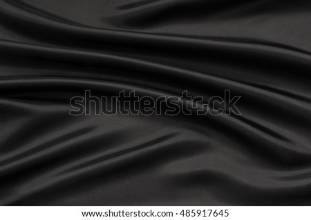 Texture of the satin fabric with folds