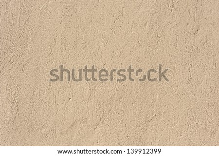 Texture of the walls covered with beige stucco - stock photo