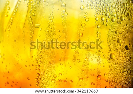 Texture of water drops on the glass beer - stock photo