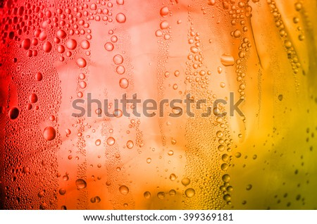 Texture of water drops on the glass beer background with a pastel colored - stock photo