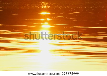 texture of water.sunset, sunrise, sun reflected in water - stock photo
