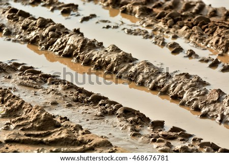 Texture of wheel track on dirty soil.