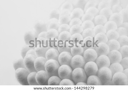 Texture of White Cleaning Cotton Buds (Cotton Swabs or Ear Buds), macro shot front view against a white background.