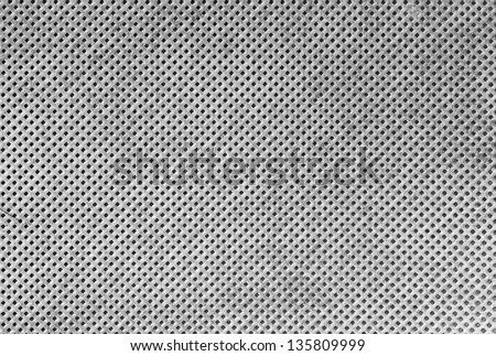 Texture of white cloth with holes in staggered rows - stock photo