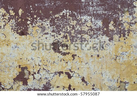 Texture of yellow-brown old shabby painted wall - stock photo