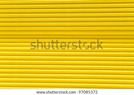 Texture of yellow corrugate cardboard as background - stock photo