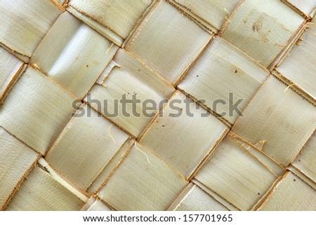 Texture of zigzag interlocking palm leaf pattern use for background - stock photo