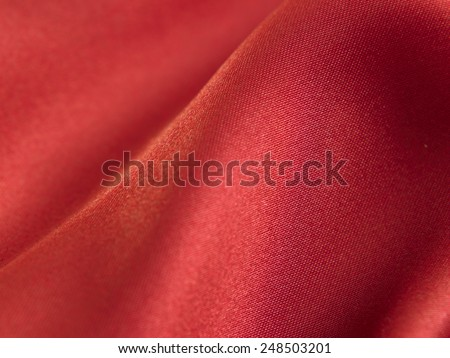 texture on the red satin cloth - stock photo