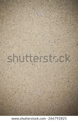 Texture recycled compressed wood chippings board background.