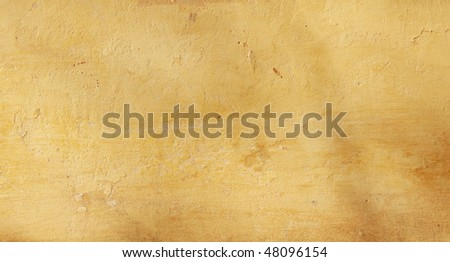 Texture stucco of ochre color - stock photo