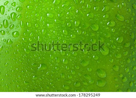 Texture water drops on the apple, background - stock photo