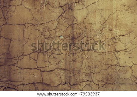 Texture yellow cement wall with cracks closeup - stock photo